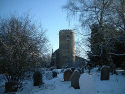 View of yaxham church in winter